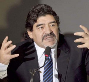 Football legend Argentinian Diego Maradona gestures during a press conference on February 26, 2013 in Naples. Maradona, who rarely stepped foot in Italy since leaving under a cloud in the 1990s amid claims of collusion with mafia dons and a positive drugs test for cocaine, asked for