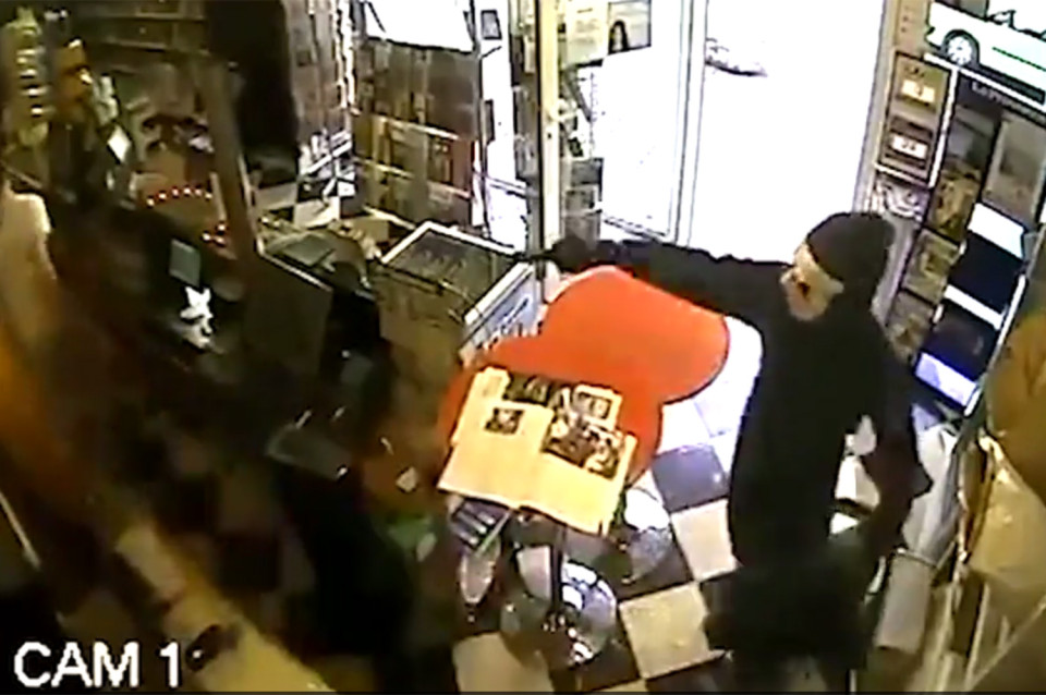 Screen grab taken from CCTV footage: Thief left empty handed as clever shop owner trains his dog to attack on command